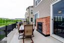 Patio with fire place - 42238 PALLADIAN BLUE TER, BRAMBLETON