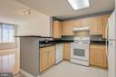 Galley kitchen, granite countertops - 2726 GALLOWS RD #201, VIENNA