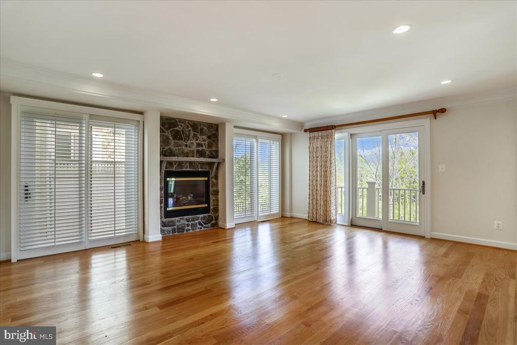 Living room with gas fireplace & doors to deck - 126 N JAY ST, MIDDLEBURG