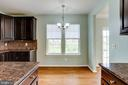 Opening from Kitchen to Dining Room - 20580 HOPE SPRING TER #207, ASHBURN