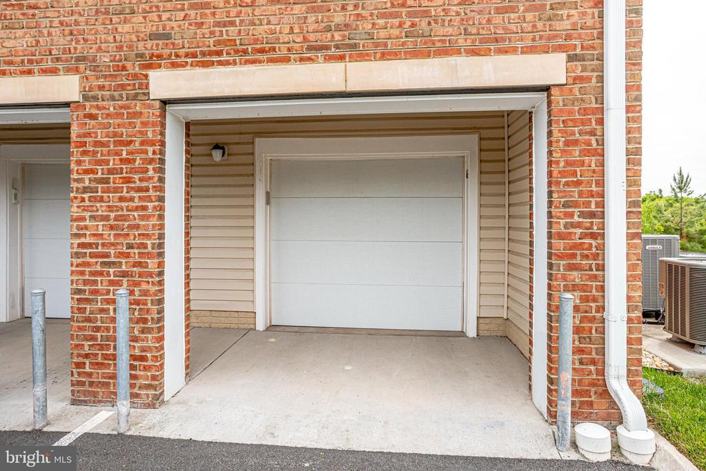 Outside of Garage, allowing Room to Park - 20580 HOPE SPRING TER #207, ASHBURN