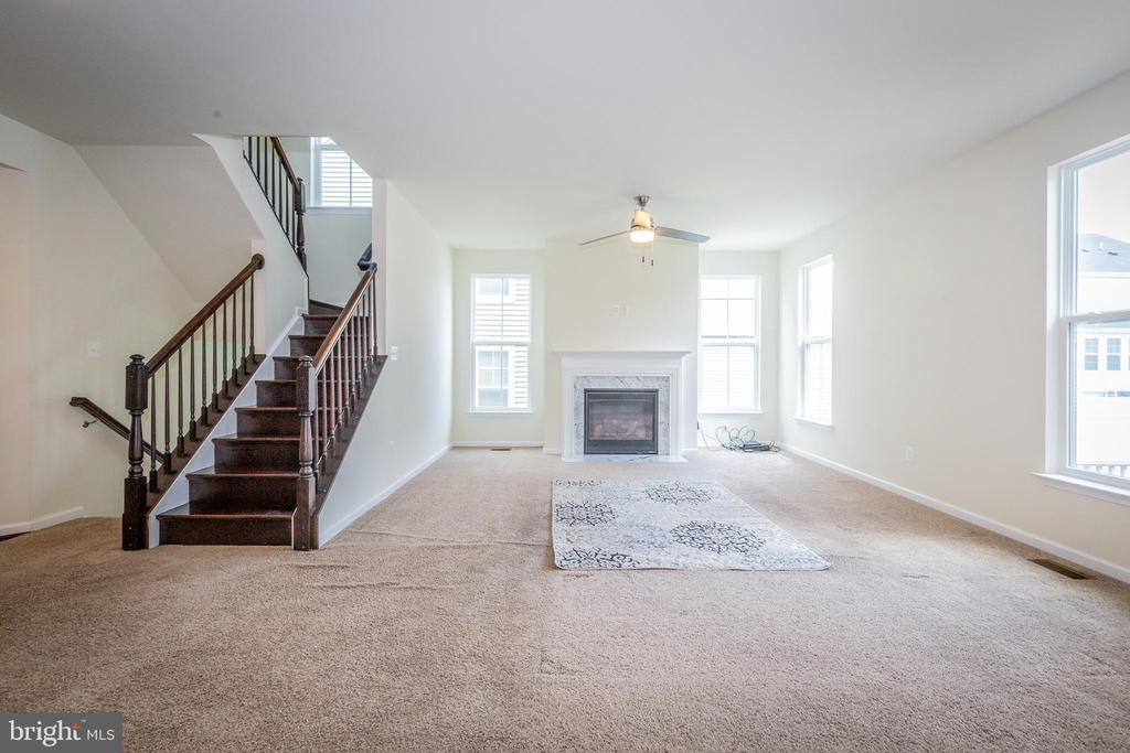 Gas fireplace for warmth and coziness. - 502 APRICOT ST, STAFFORD
