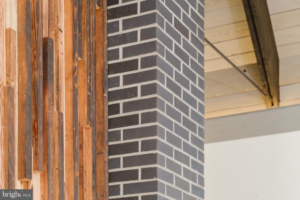 Brick and wood fireplace wall structure� - 1120 GUILFORD CT, MCLEAN