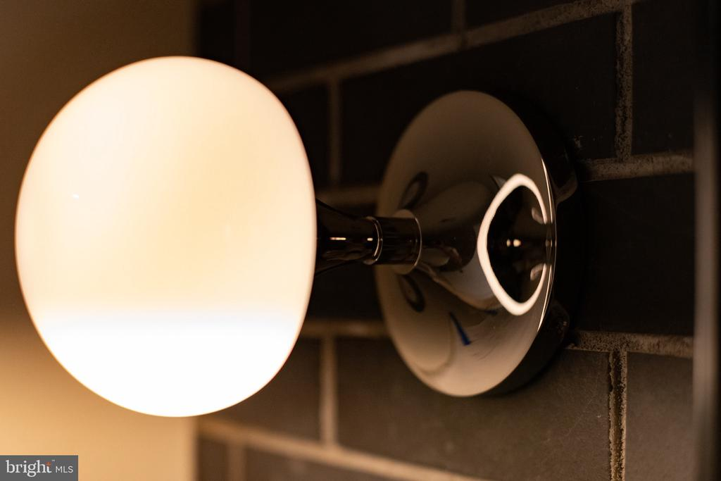 Modern vanity wall sconce on brick wall - 1120 GUILFORD CT, MCLEAN