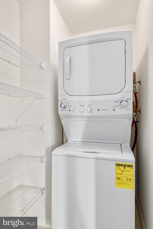 Laundry closet with shelving - 19365 CYPRESS RIDGE TER #1109, LEESBURG