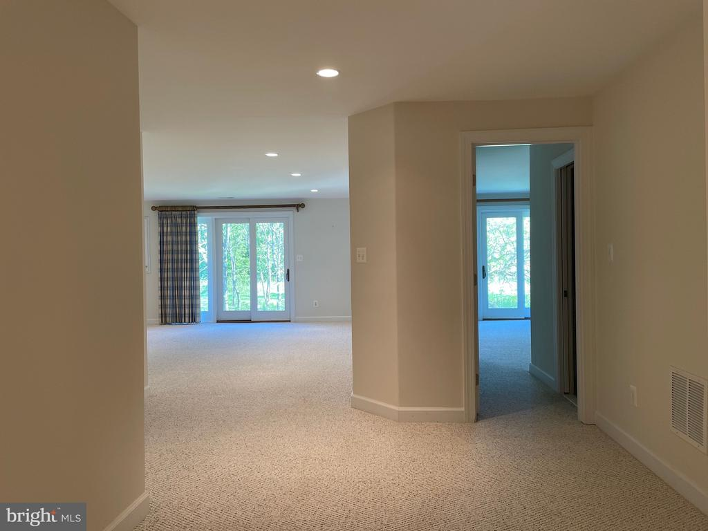 Lower level looking towards game rm and bedroom - 126 N JAY ST, MIDDLEBURG