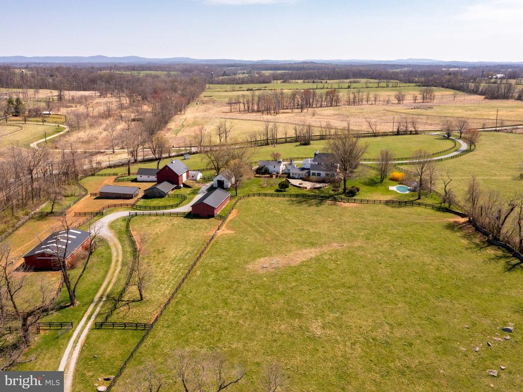 View of stable, barns and home - 20775 AIRMONT RD, BLUEMONT