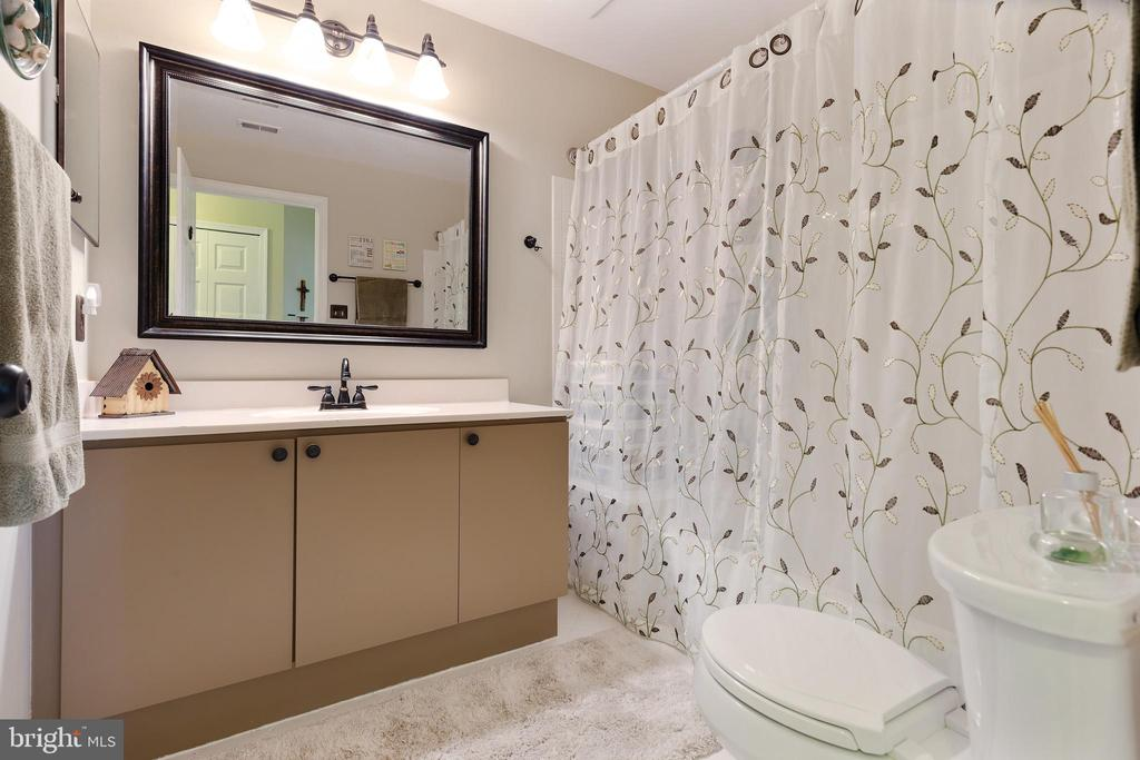 Bathroom with Updated Lighting, Mirrors & Faucet - 20576 SNOWSHOE SQ #101, ASHBURN