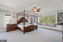 Owner Bedroom with Bespoke Bookshelves and Nook - 43327 RIVERPOINT DR, LEESBURG