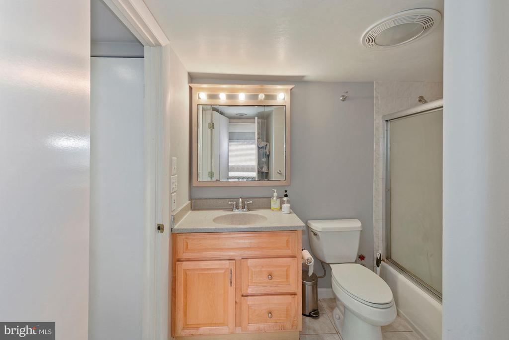 Bathroom with tub and shower. - 2111 WISCONSIN AVENUE, NW #420, WASHINGTON