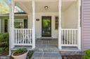 Welcoming covered front porch - 13619 BRIDGELAND LN, CLIFTON