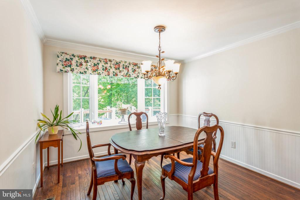Formal dining room with wainscotting - 13619 BRIDGELAND LN, CLIFTON
