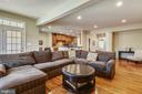 Family room with hardwood floors - 24953 EARLSFORD DR, CHANTILLY