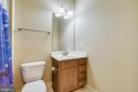 Lower level half bath - 24953 EARLSFORD DR, CHANTILLY