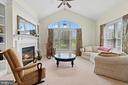 Charming fireplace in primary bedroom sitting area - 9903 S HARRIS FARM RD, SPOTSYLVANIA