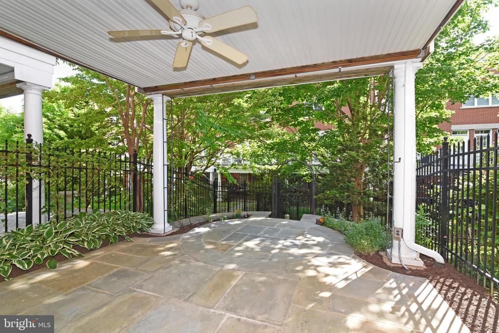 Flagstone patio with rain protected roof - 12143 CHANCERY STATION CIR, RESTON