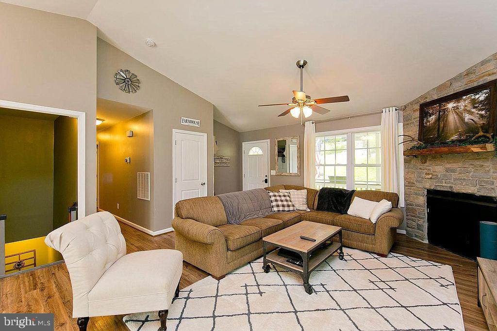 Living space-stone propane fireplace - 677 NORTHERN SPY DR, LINDEN