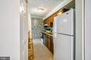 GALLEY KITCHEN WITH WOOD CABINETS - 12407 HICKORY TREE WAY #533, GERMANTOWN