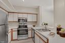 Kitchen with stainless steel appliances! - 2100 LEE HWY #G11, ARLINGTON