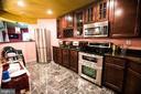 Rec room full kitchen - 25103 HIGHLAND MANOR CT, GAITHERSBURG