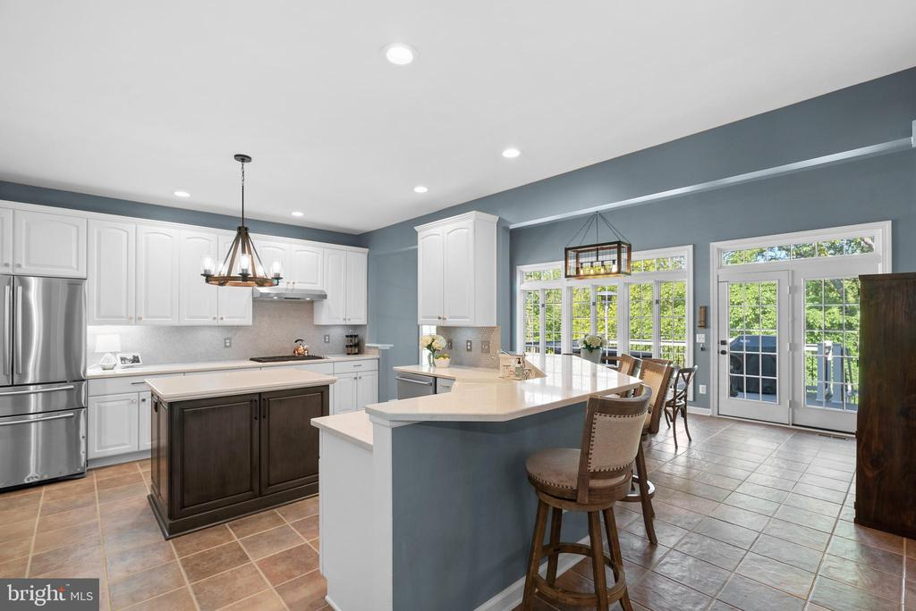 Quartz-topped Breakfast Bar in Updated Kitchen - 47273 OX BOW CIR, STERLING