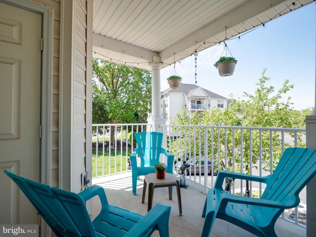 Over sized covered balcony with a quiet view - 25300 LAKE MIST SQ #205, CHANTILLY