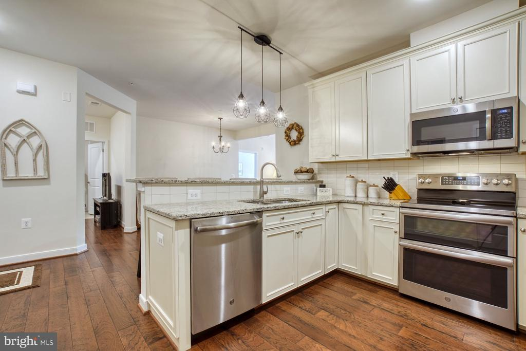 Kitchen has Oversized Walk-in Pantry - 43095 WYNRIDGE DR #203, BROADLANDS