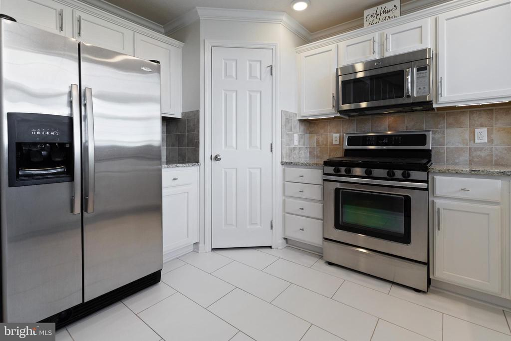 Newly Painted White Cabinets with New Hardware - 505 SUNSET VIEW TER SE #308, LEESBURG