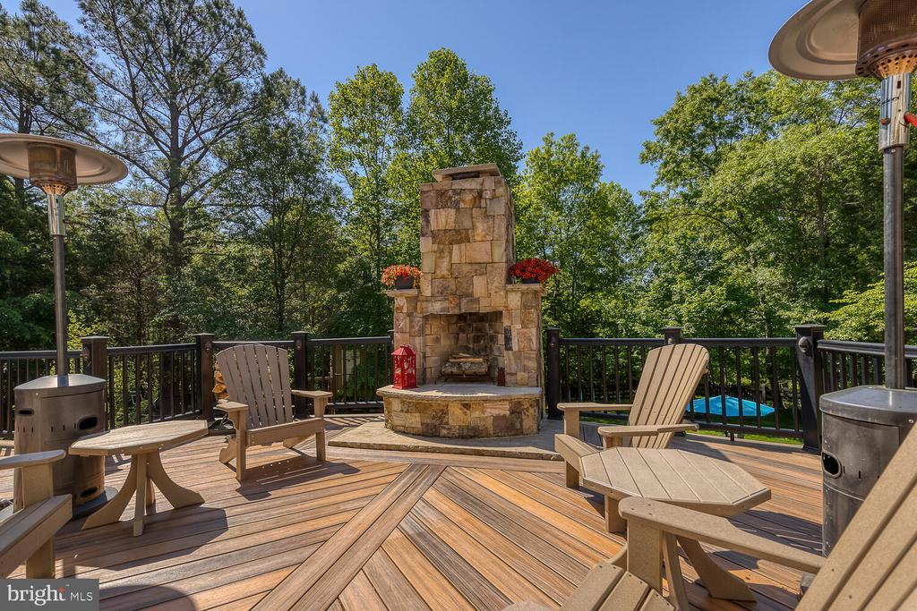 Deck with outdoor fireplace. - 42091 NOLEN CT, LEESBURG