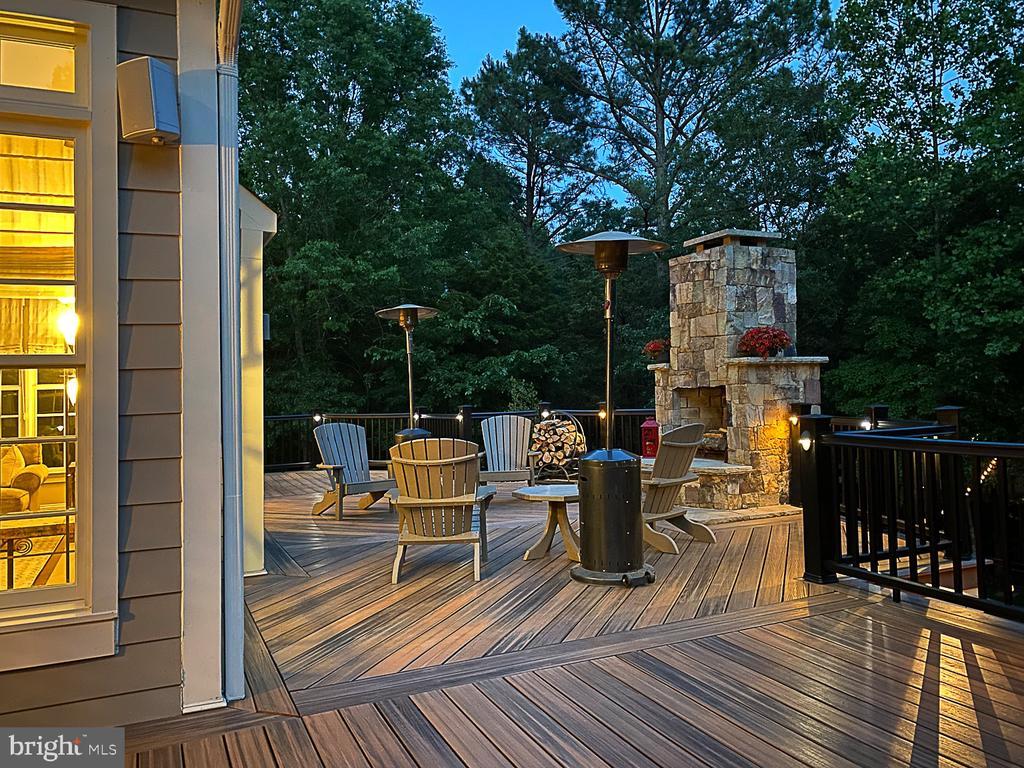 Expansive deck with outdoor fireplace. - 42091 NOLEN CT, LEESBURG