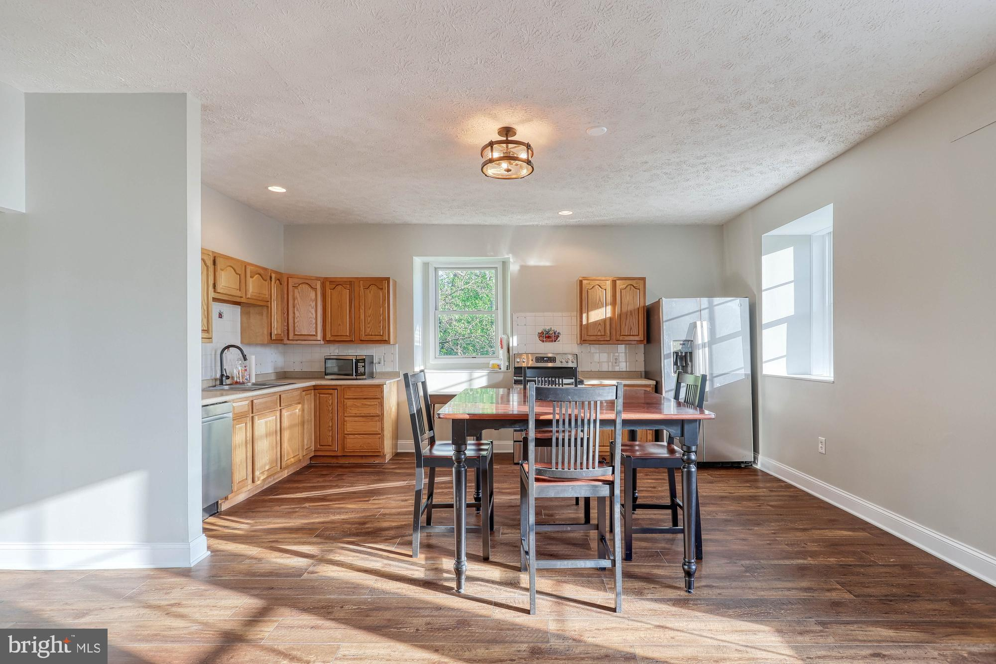 open concept kitchen/dining/living in millhouse