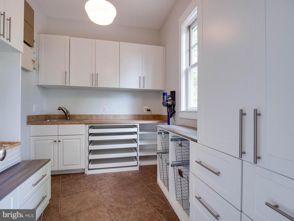 Off the kitchen is a mud room  and then some - 4651 35TH ST N, ARLINGTON
