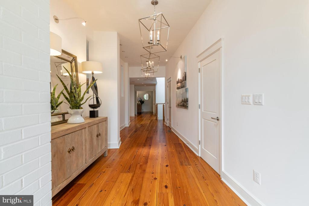 Hallway is bright with gorgeous hardwood floors - 5075 POLK AVE, ALEXANDRIA