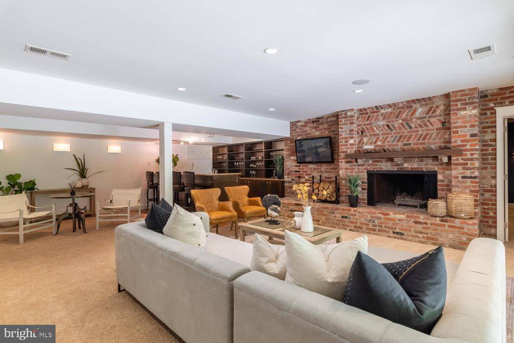 Lower level recreation room with Brick Fireplace - 5075 POLK AVE, ALEXANDRIA