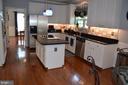Stunning kitchen with brand new back splash - 6304 SPRING FOREST RD, FREDERICK