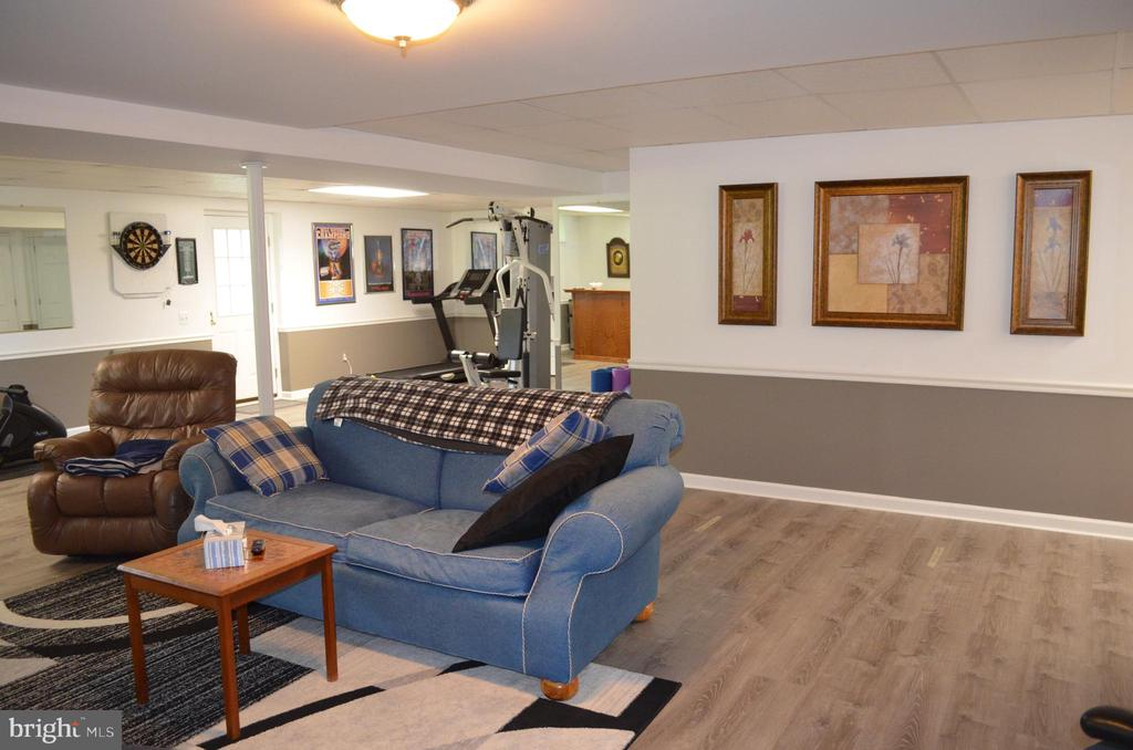 Lower level has new flooring and plenty of space! - 6304 SPRING FOREST RD, FREDERICK
