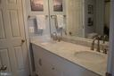 Jack and Jill bath with double-sinks - 6304 SPRING FOREST RD, FREDERICK