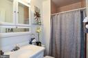 Master bathroom with plenty of storage space. - 6463 FENESTRA CT #50C, BURKE