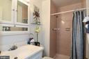 Floor to ceiling tiling in the master bathroom. - 6463 FENESTRA CT #50C, BURKE