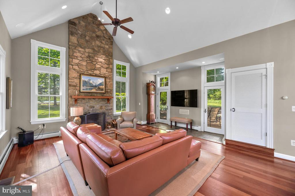 Great room with stone fireplace - 12645 OLD FREDERICK RD, SYKESVILLE