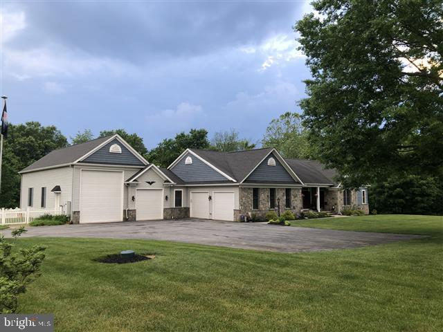Double Garages can store a Boat and RV together. - 2844 URBANA PIKE, IJAMSVILLE