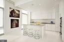 The sleek kitchen features an oversized island - 1177 22ND ST NW #9G, WASHINGTON
