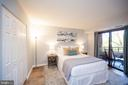 large bedroom with 2 closets and balcony access - 2400 CLARENDON BLVD #301, ARLINGTON