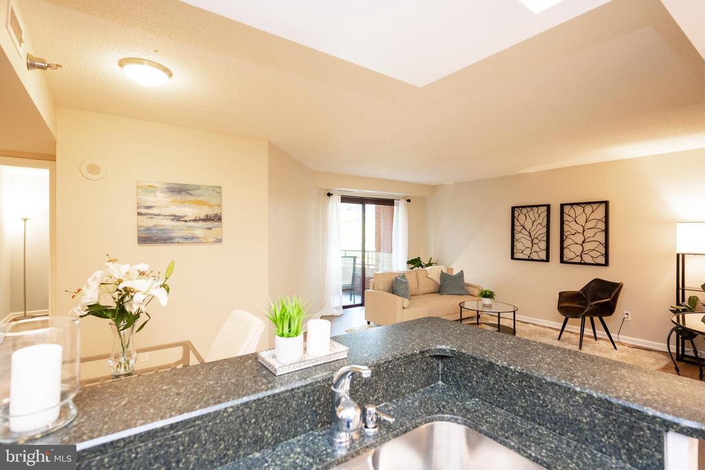 Dining Room and Living Room from the kitchen - 2400 CLARENDON BLVD #301, ARLINGTON