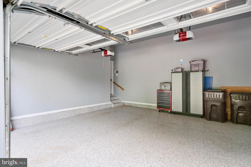 The perfect garage with storage racks above - 17037 SILVER ARROW DR, DUMFRIES