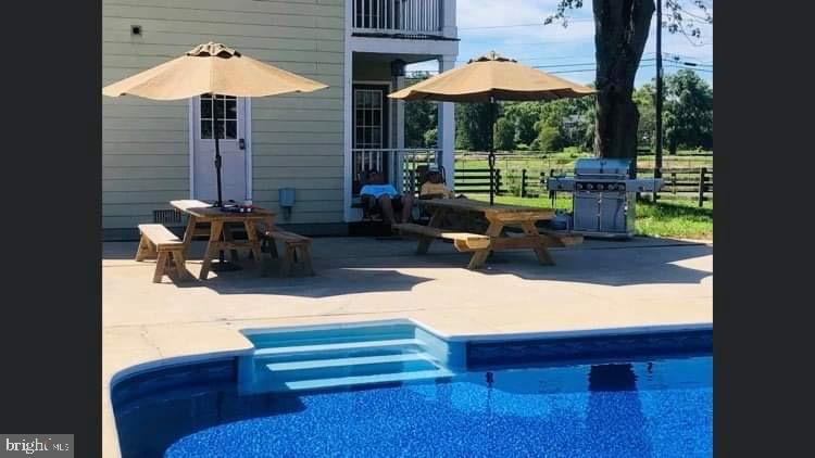 Pool andPool when open patio ( pool not open ) - 10302 COPPERMINE RD, WOODSBORO