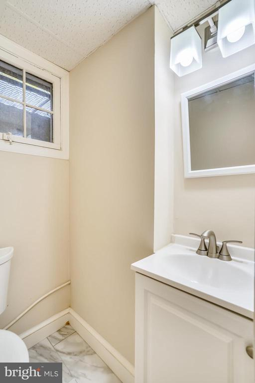 Renovated, lower level half bath - 900 MCCENEY AVE, SILVER SPRING