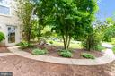 Rear pathway with basement entry - 8531 W HOWELL RD, BETHESDA