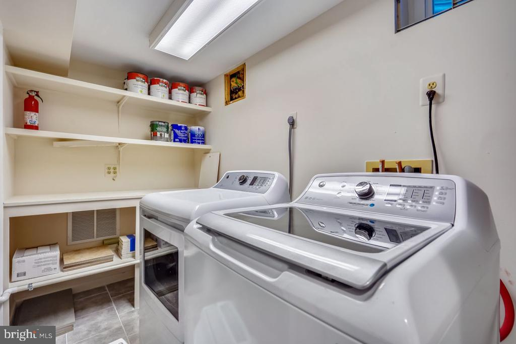 Laundry room with shelves - 2564-A S ARLINGTON MILL DR S #5, ARLINGTON