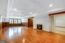 Large lower lever family room with new woodstove - 6801 GRANBY ST, BETHESDA